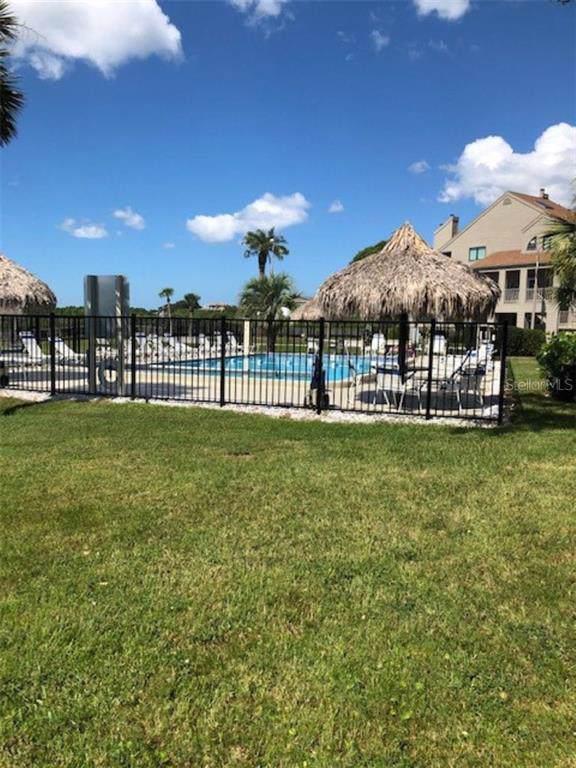 409 Windrush Bay Drive #409, Tarpon Springs, FL 34689 (MLS #A4448251) :: Alpha Equity Team