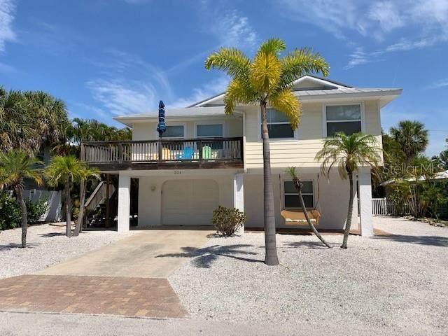 204 71ST Street, Holmes Beach, FL 34217 (MLS #A4500565) :: McConnell and Associates