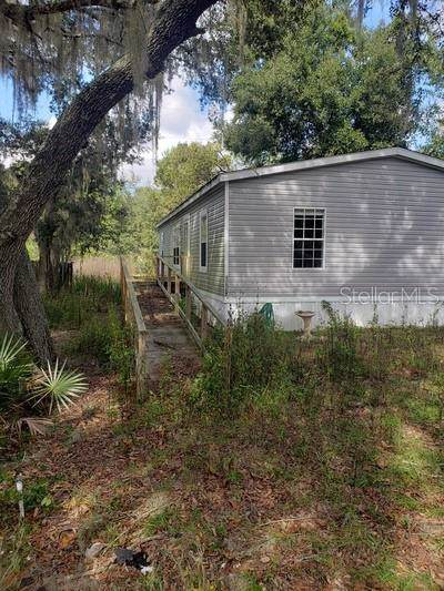 12562 SE 143RD Court, Ocklawaha, FL 32179 (MLS #G5023457) :: Cartwright Realty