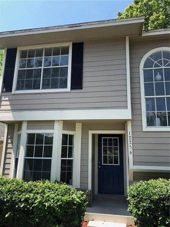 12256 Shady Springs #107, Orlando, FL 32828 (MLS #G5037970) :: Everlane Realty