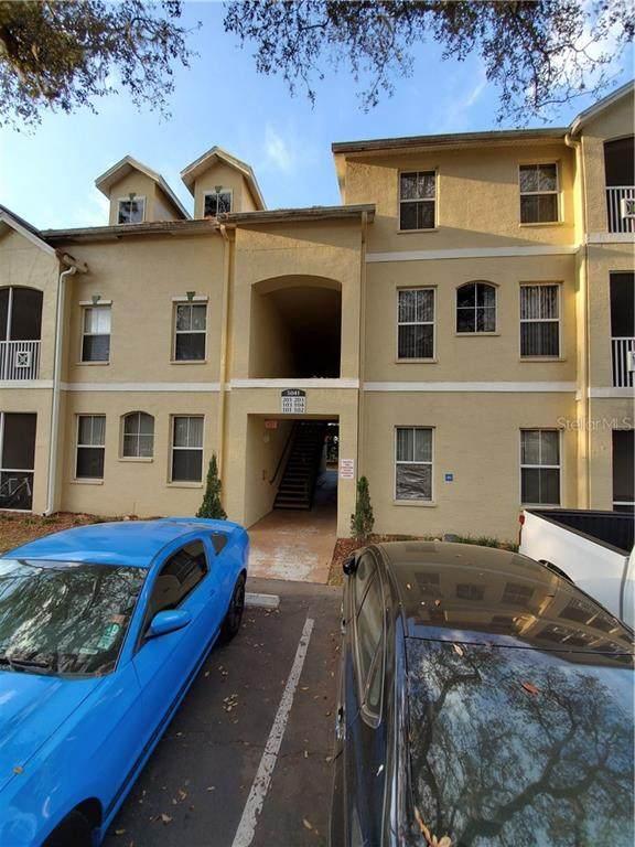 5041 Sunridge Palms Drive #103, Tampa, FL 33617 (MLS #L4914772) :: Griffin Group