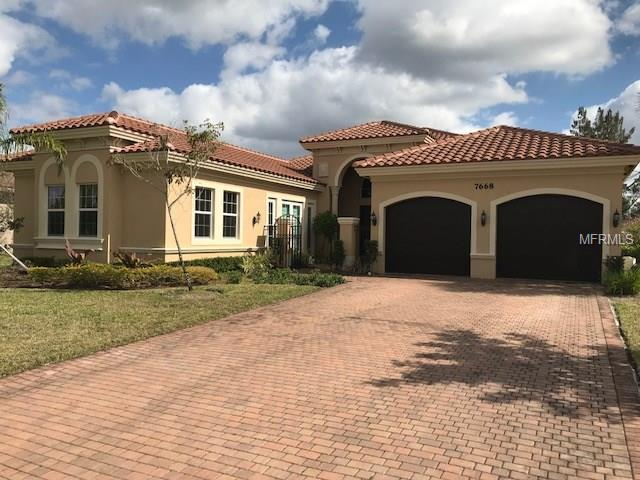 7668 Maywood Crest Drive, Palm Beach Gardens, FL 33412 (MLS #O5560269) :: Griffin Group