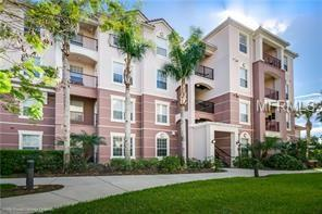 4024 Breakview Dr #406, Orlando, FL 32819 (MLS #O5573364) :: Gate Arty & the Group - Keller Williams Realty