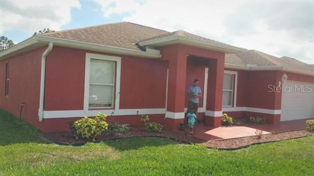 731 Chapman Avenue S, Lehigh Acres, FL 33974 (MLS #O5797295) :: Jeff Borham & Associates at Keller Williams Realty