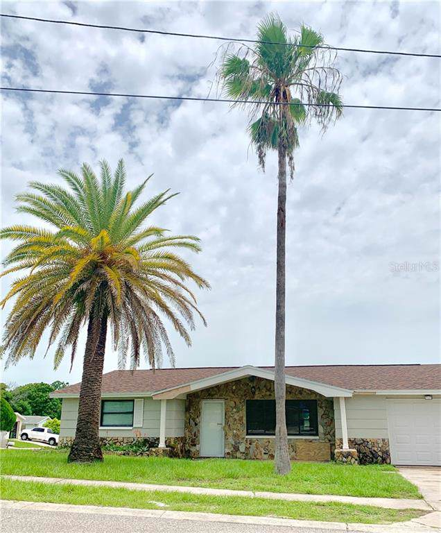 1504 Plum Tree Road, Holiday, FL 34690 (MLS #O5798670) :: The Duncan Duo Team