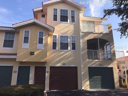 12209 Wild Iris Way #107, Orlando, FL 32837 (MLS #O5798694) :: Bridge Realty Group
