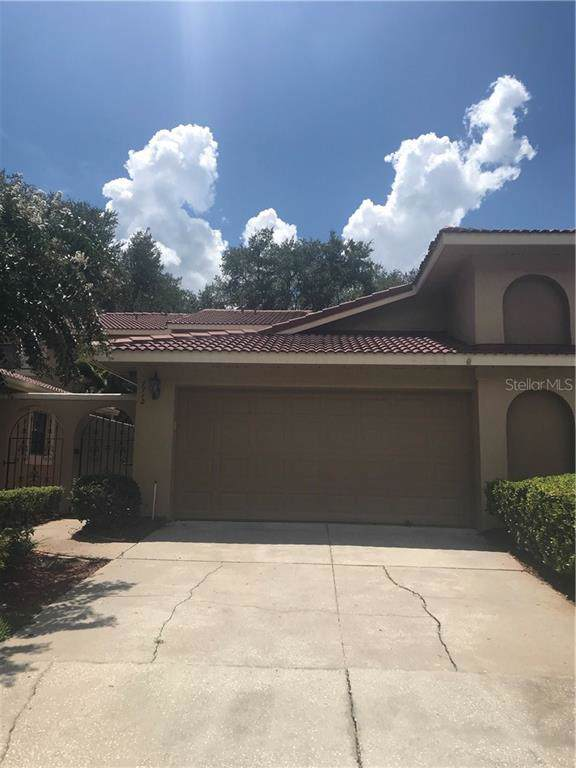 7712 Windbreak Road, Orlando, FL 32819 (MLS #O5807361) :: Premium Properties Real Estate Services