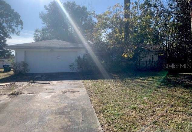 1033 Madura Drive, Deltona, FL 32725 (MLS #O5831377) :: Premium Properties Real Estate Services