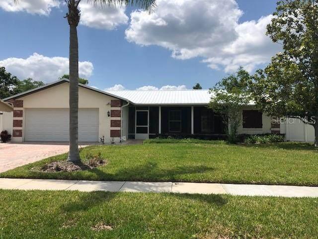 5230 Ridgeway Drive, Orlando, FL 32819 (MLS #O5869433) :: Team Bohannon Keller Williams, Tampa Properties