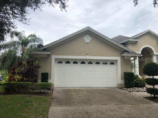 3957 Hunters Isle Drive, Orlando, FL 32837 (MLS #O5900840) :: Bustamante Real Estate
