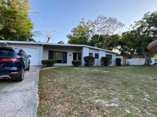 5216 Van Aken Drive, Orlando, FL 32808 (MLS #O5936175) :: The Kardosh Team
