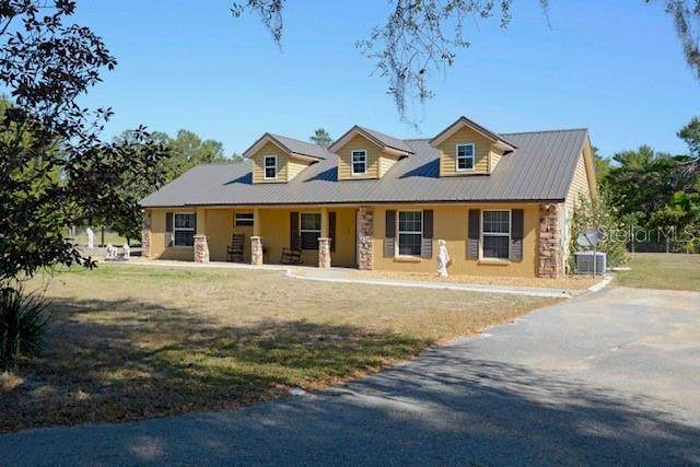 23211 Outback Lane, Eustis, FL 32736 (MLS #O5937338) :: Visionary Properties Inc