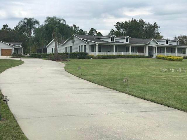 14025 Hunters Trace Lane, Clermont, FL 34715 (MLS #O5937958) :: Visionary Properties Inc