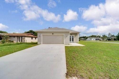 1209 Tivoli Drive, Deltona, FL 32725 (MLS #O5979075) :: Everlane Realty
