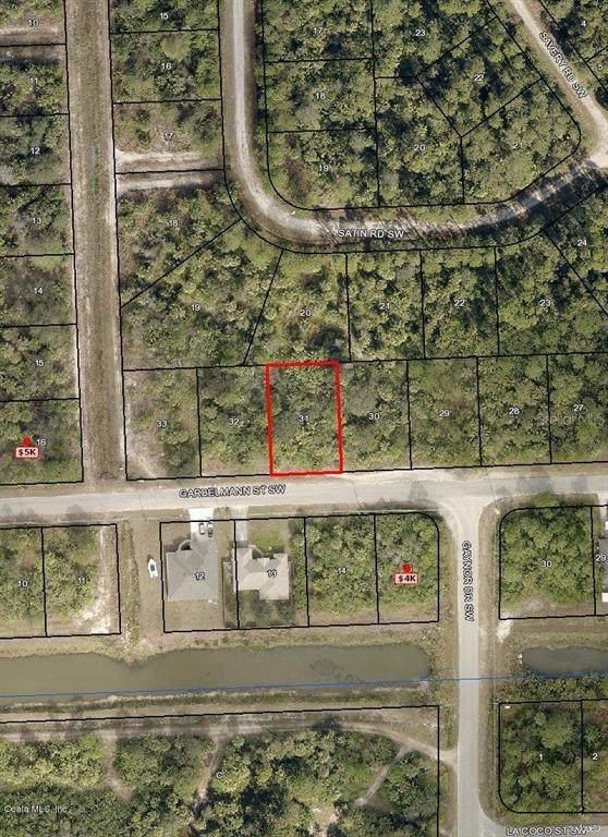 517 SW Garbelmann Street, Palm Bay, FL 32908 (MLS #OM542857) :: Premium Properties Real Estate Services