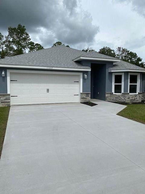 11642 SE 84TH Avenue, Belleview, FL 34420 (MLS #OM605639) :: Griffin Group