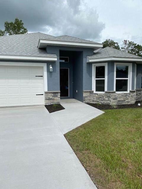 12210 SE 84TH Terrace, Belleview, FL 34420 (MLS #OM627554) :: Prestige Home Realty