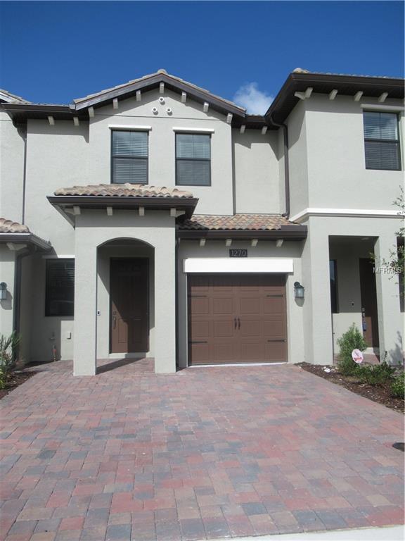 1270 Royal St George Boulevard, Davenport, FL 33896 (MLS #S5003390) :: RE/MAX Realtec Group