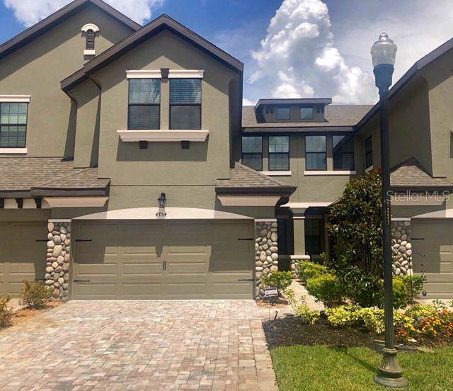 4754 Wandering Way, Wesley Chapel, FL 33544 (MLS #S5020543) :: The Robertson Real Estate Group