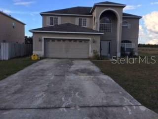 2501 Rock Place, Poinciana, FL 34759 (MLS #S5021655) :: The Brenda Wade Team