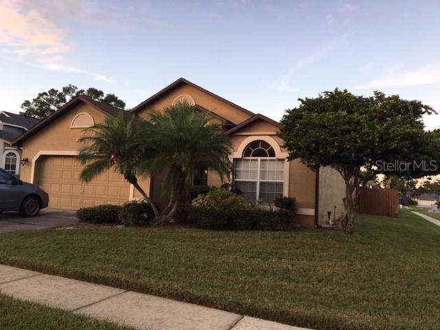 12725 Paddle Court, Orlando, FL 32828 (MLS #S5026286) :: KELLER WILLIAMS ELITE PARTNERS IV REALTY