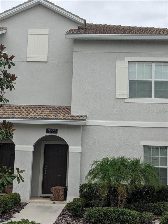1597 Moon Valley Drive, Champions Gate, FL 33896 (MLS #S5035031) :: Delgado Home Team at Keller Williams