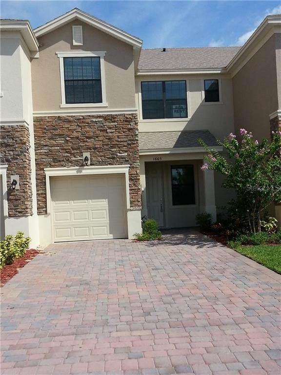 1985 Portofino Meadows Boulevard, Orlando, FL 32824 (MLS #S5036593) :: Cartwright Realty