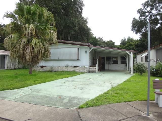 3552 Castle Drive, Zephyrhills, FL 33540 (MLS #T3130200) :: The Duncan Duo Team