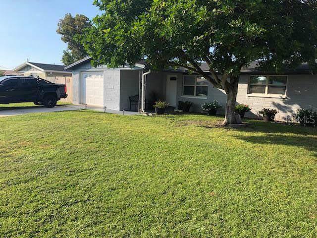 3819 Elmwood Dr, Holiday, FL 34691 (MLS #T3192530) :: Bridge Realty Group