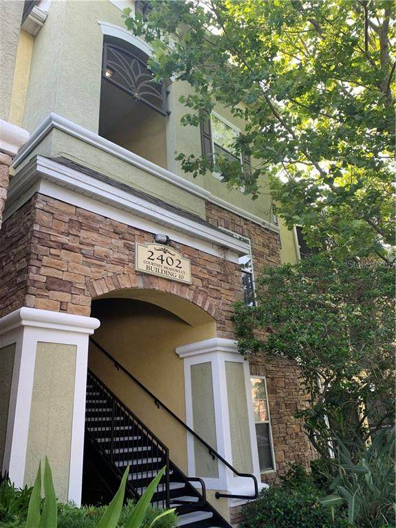 2402 Courtney Meadows Court #102, Tampa, FL 33619 (MLS #T3245382) :: Armel Real Estate