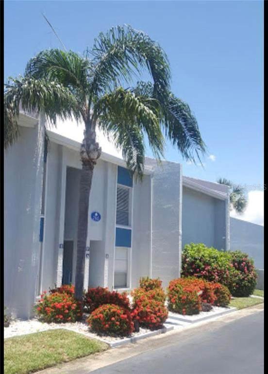 230 Medallion Boulevard E, Madeira Beach, FL 33708 (MLS #T3250645) :: Team Borham at Keller Williams Realty
