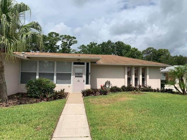 1001 Queen Anne Drive A, Palm Harbor, FL 34684 (MLS #T3310773) :: Delgado Home Team at Keller Williams