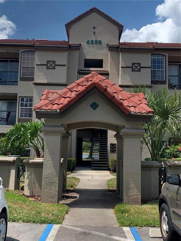4209 Woodstorks Walk Way #1311, Lutz, FL 33558 (MLS #T3321353) :: Bob Paulson with Vylla Home