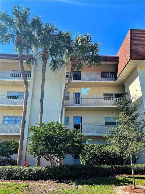 209 NE Lincoln Circle N #303, St Petersburg, FL 33702 (MLS #U8102812) :: Griffin Group