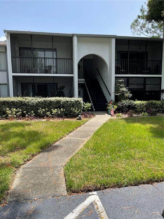1281 Pine Ridge Circle E E2, Tarpon Springs, FL 34688 (MLS #U8135476) :: Medway Realty