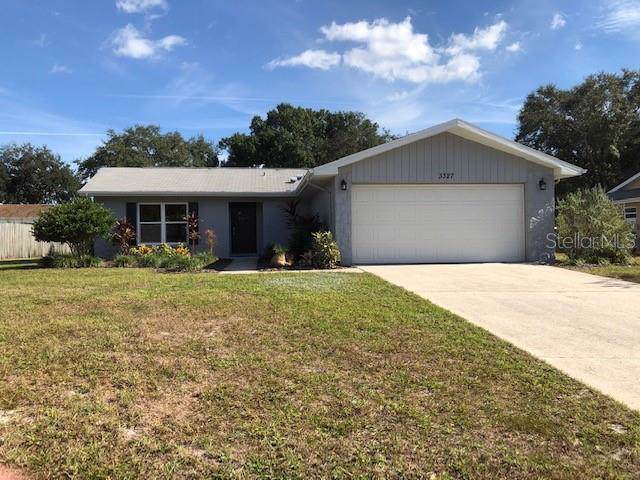 3327 Wind Chime Drive W, Clearwater, FL 33761 (MLS #W7818543) :: The Duncan Duo Team