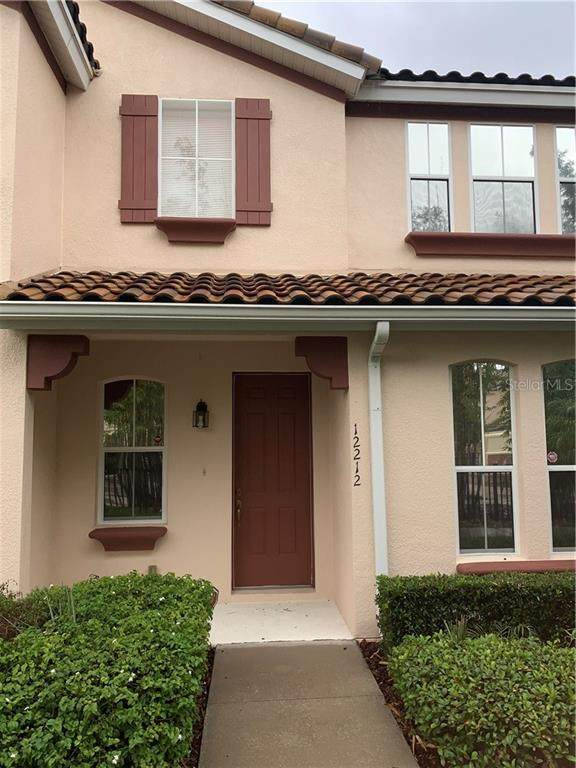 12212 Triton Lane #11, Orlando, FL 32837 (MLS #S5041907) :: Carmena and Associates Realty Group