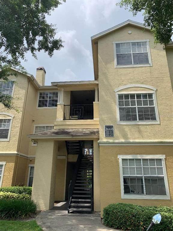 2668 Robert Trent Jones Drive #416, Orlando, FL 32835 (MLS #S5050168) :: Your Florida House Team