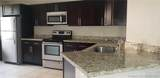 8977 Wiles Rd - Photo 2