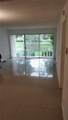 9001 Wiles Rd - Photo 23