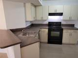 9001 Wiles Rd - Photo 10