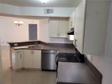 9001 Wiles Rd - Photo 11