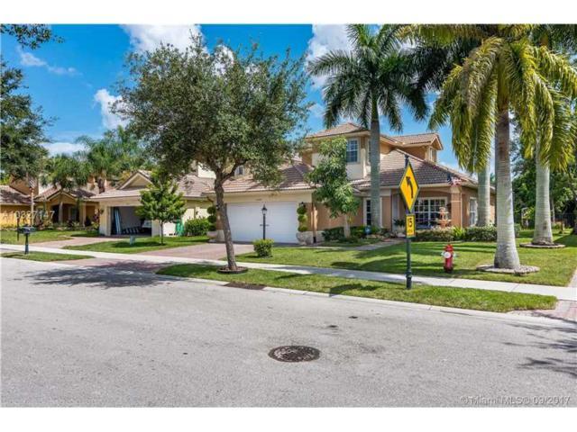 10884 NW 61st Ct, Parkland, FL 33076 (MLS #A10327147) :: Stanley Rosen Group