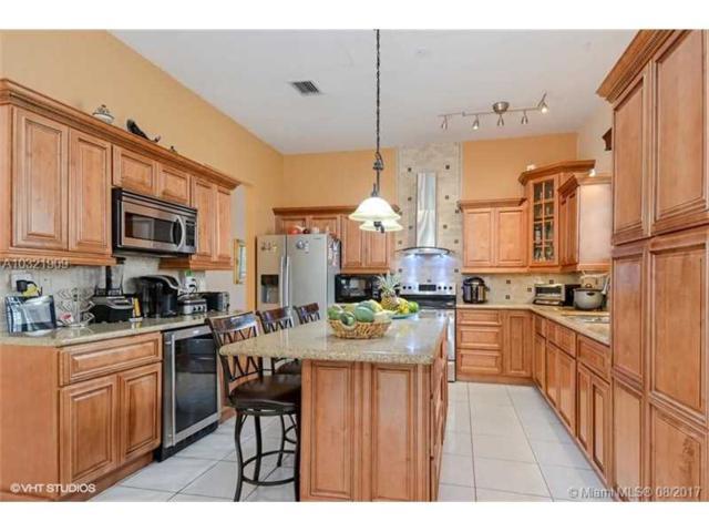 8824 NW 147th Ln, Miami Lakes, FL 33018 (MLS #A10321909) :: Green Realty Properties