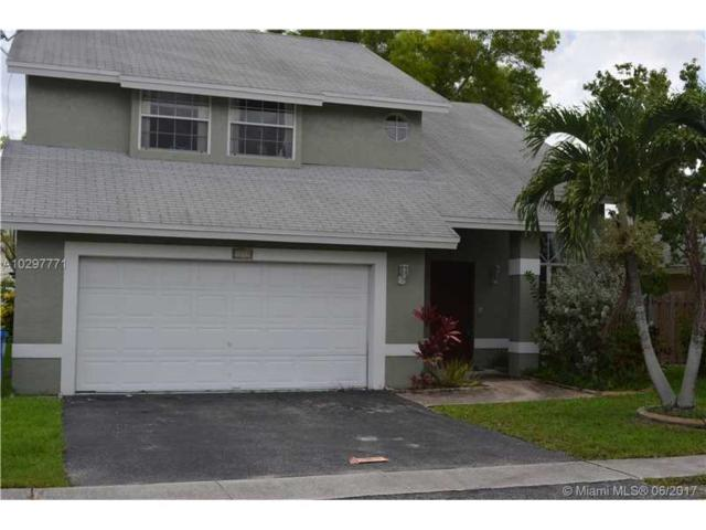 3110 NW 122nd Ave, Sunrise, FL 33323 (MLS #A10297771) :: The Teri Arbogast Team at Keller Williams Partners SW
