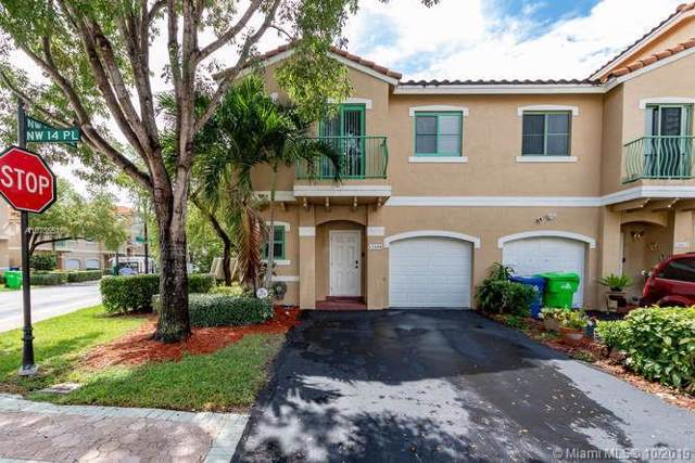 12606 NW 14th Pl, Sunrise, FL 33323 (MLS #A10755516) :: Patty Accorto Team