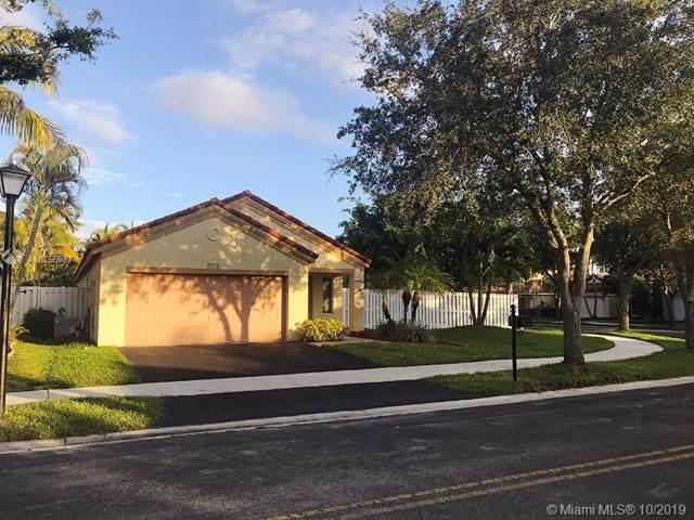 1476 Presidio Dr, Weston, FL 33327 (MLS #A10756987) :: The Howland Group
