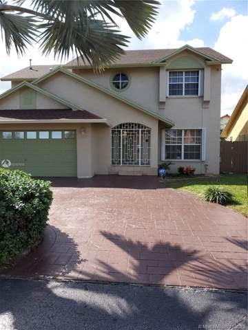 18638 NW 77th Pl, Hialeah, FL 33015 (MLS #A10767516) :: Berkshire Hathaway HomeServices EWM Realty