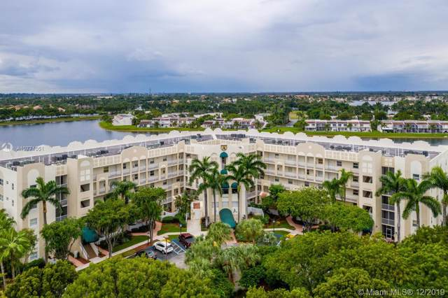 10730 NW 66th St #211, Doral, FL 33178 (MLS #A10771051) :: RE/MAX Presidential Real Estate Group