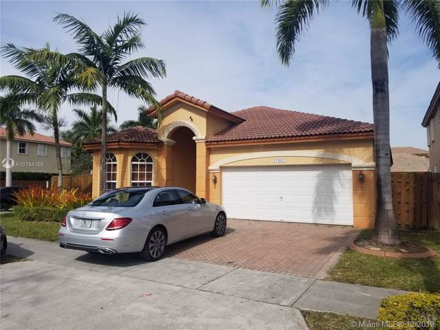 11061 NW 84th St, Doral, FL 33178 (MLS #A10784159) :: Grove Properties